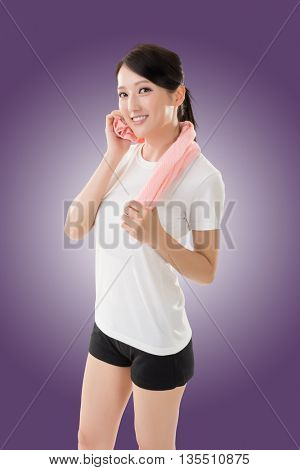 Smiling sporty asian woman take a rest after training. Closeup portrait