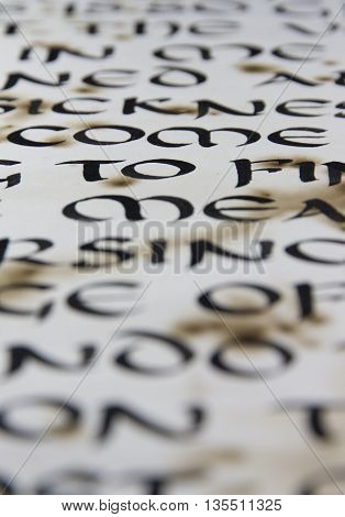 An old paper and caligraphy  letters close-up