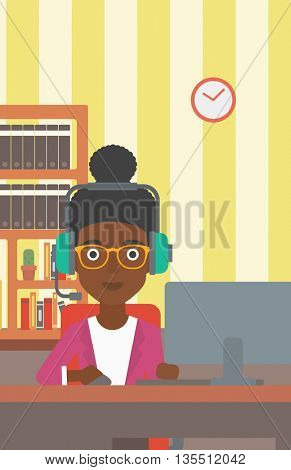 An african-american woman in headphones sitting in front of computer monitor with mouse in hand on the background ofliving room vector flat design illustration. Vertical layout.