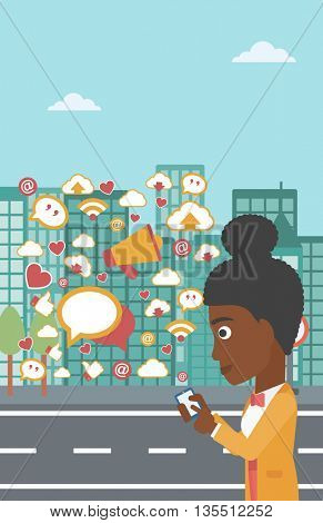 An african-american woman using smartphone with lots of social media application icons flying out on a city background vector flat design illustration. Vertical layout.