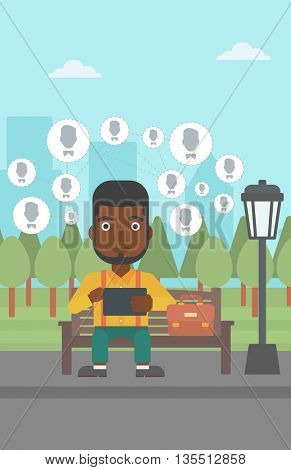 An african-american man sitting on a bench in the park and holding a tablet computer with many avatar icons above vector flat design illustration. Vertical layout.