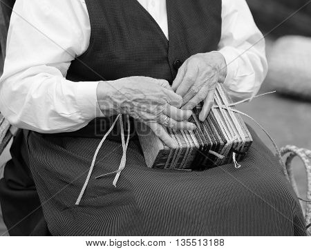 Hands Of An Elderly Woman While Creating A Bag