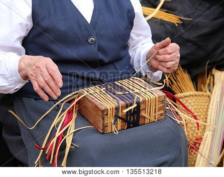 Elderly Woman While Creating A Straw Bag