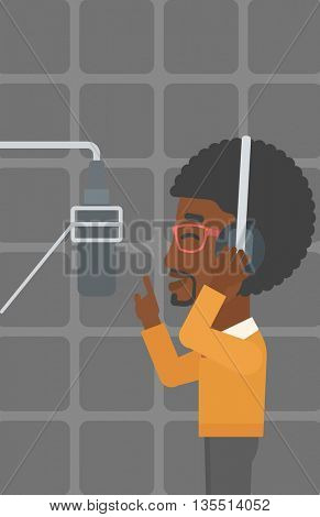 An african-american man in headphones making a record of his voice in studio vector flat design illustration. Vertical layout.