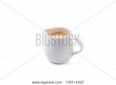 White Jar of Sweetened condensed milk isolated on white background.