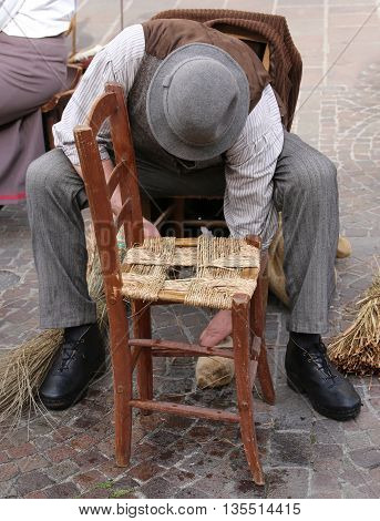 Senior Artisan Mender Of Chairs With Woven Straw Shelters The Ol