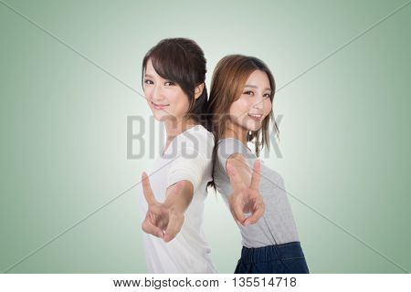 Asian woman give you a victory sign.
