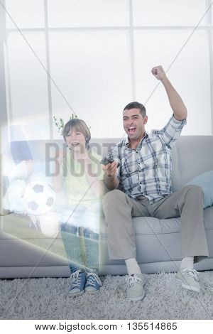 Composite image of father and son are watching sport match on television at home