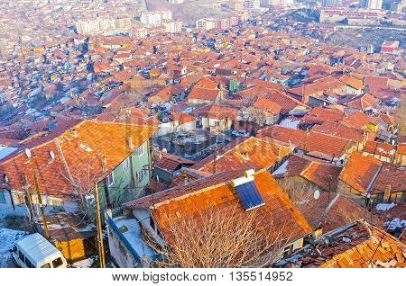 The red roofs of the Turkish village district surround the Castle Hill and occupy the large area of the city Ankara Turkey.
