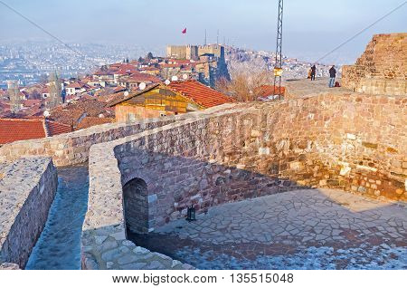 The hexagonal stone tower is the best viewpoint overlooking the roofs of the old town and the Hisar Citadel of Ankara Turkey.