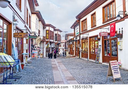 ANKARA TURKEY - JANUARY 16 2015: The scenic tourist neighborhood with renovated wooden cottages traditional stalls and workshops on January 16 in Ankara.