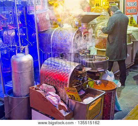 ANKARA TURKEY - JANUARY 16 2015: The chickpeas are very popular in Turkey so the roasting machines often located in the crowded places on January 16 in Ankara.