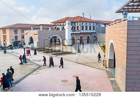 ANKARA TURKEY - JANUARY 16 2015: The modern architectural complex around Haci Bayram Mosque includes underground shopping area wide square scenic park cafes and restaurants on January 16 in Ankara.