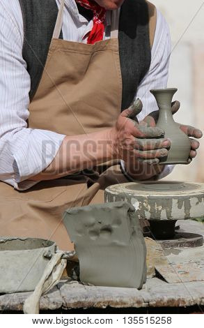 Potter Working With The Lathe During Manufacture Of A Clay Vase