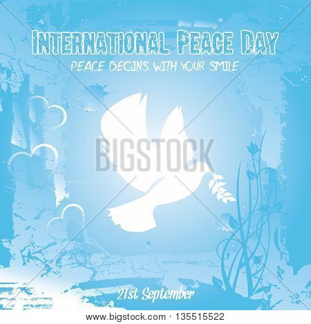 Single dove carrying an olive branch with hearts and flora on a grungy background for International Peace Day