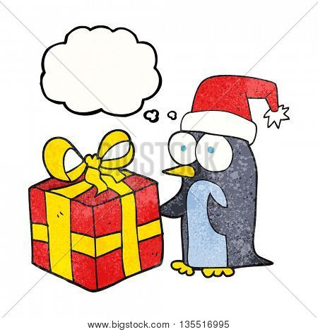 freehand drawn thought bubble textured cartoon christmas penguin with present