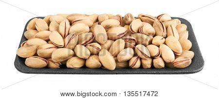 Pistachios in package, isolated on the white background