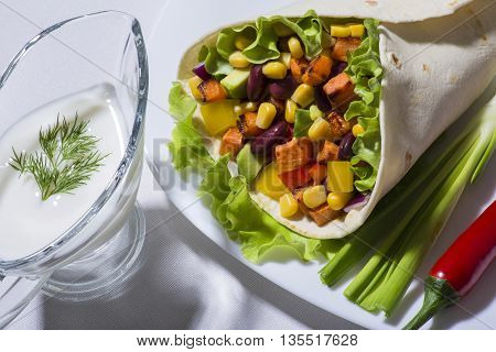 Burrito with grilled vegetables - raw food from traditional mexican kitchen