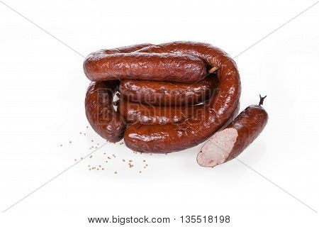 smoked sausages with a mustard seed on white background