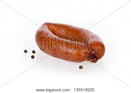 jess sausage on white background with peppercorns