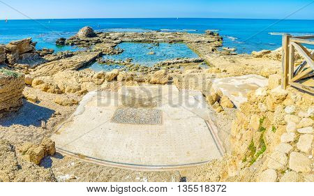 The ruins of the ancient building are partly flooded in the sea and the scenic floor mosaic preserved on shore Caesaria Israel.