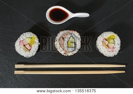 sushi pieces with soy sauce and chopsticks