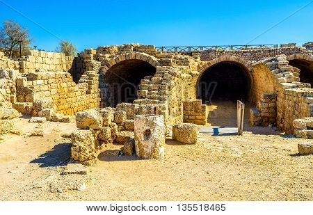 The ruins of the ancient Roman aqueduct in Caesaria National Park Israel.