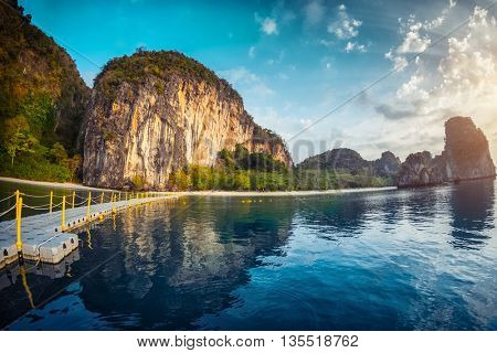 Calm bay and bridge leading to perfect tropical beach. Andaman sea, Thailand