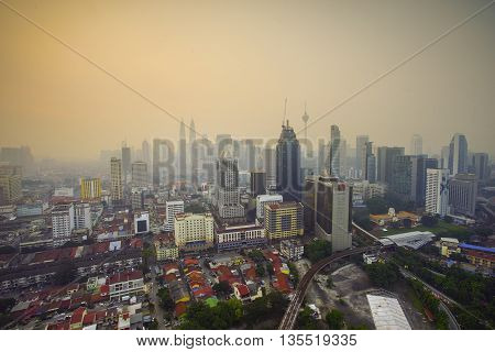 Top view of Kuala Lumper skyline during bad hazy day on warm sunrise
