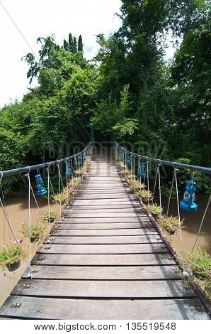 The rope bridge on river in jungle