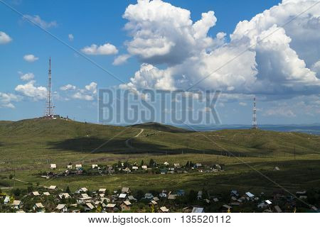 Small village close to the town, green steppe, the beautiful blue sky, summer