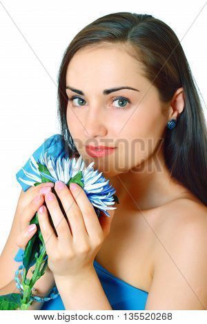Attractive young dark hair woman holds blue flower. Portrait close-up on white background, isolated