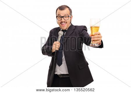 Cheerful businessman singing karaoke on microphone and holding a pint of beer isolated on white background