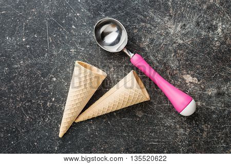 wafer cone and ice cream scoop old kitchen table