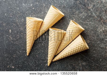 Sweet wafer cones on old kitchen table.