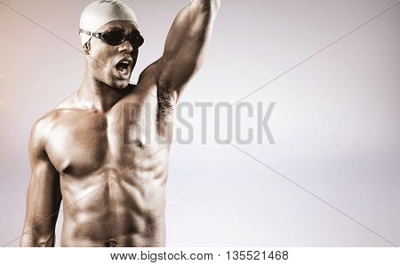 Composite image of swimmer posing after victory against grey background