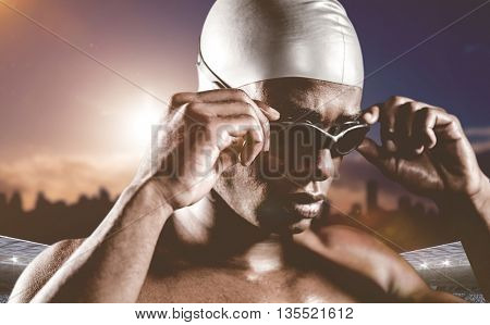 Swimmer ready to dive against composite image of stadium with cloudy sky