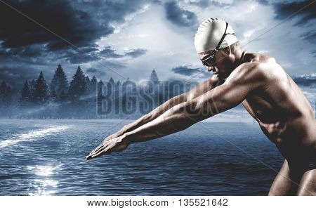 Swimmer ready to dive against country scene