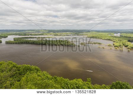 A scenic view of the Mississippi River with a boat.