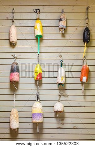 Many Colorful Lobster Floats on Wood Wall