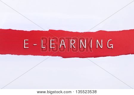 Torn paper with a e-learning word on red background.