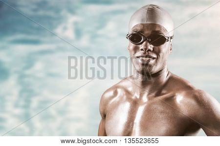 Composite image of swimmer standing with hand on hip against swimming pool