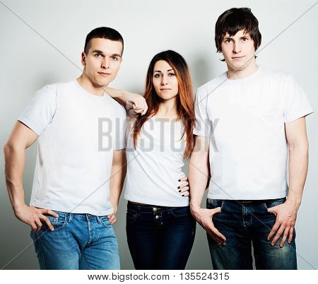 Youth. Young People Students Wearing White Empty T-Shirt. Two Guys and One Woman