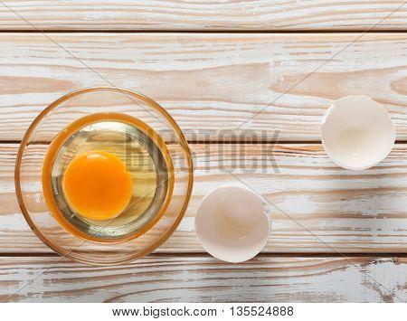 Broken Egg On Rustic Kitchen Table