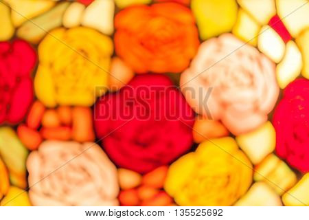 Abstract blurred photo stained glass decorative window of colorful roses.