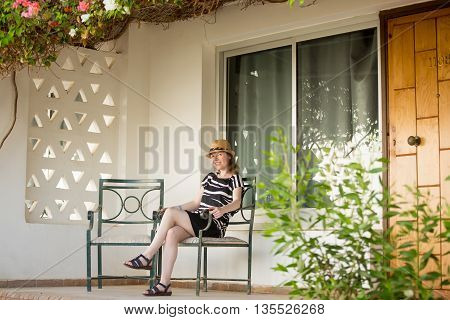 Portrait Of Young Woman On Summer Terrace