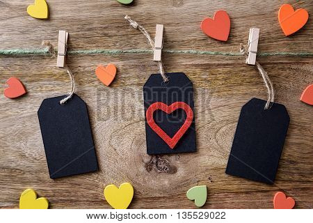 blackboard and clothespins on wood with colored heart