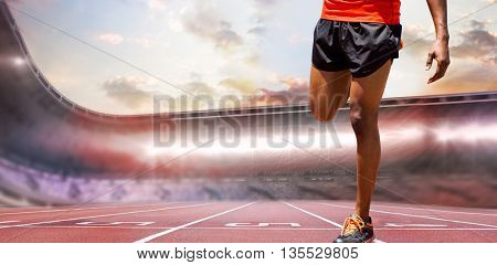 Athletic man hopping against race track