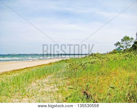 Beach between Timmendorfer Strand and Scharbeutz - dunes with grass and trees sandy beach and ocean