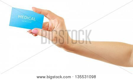 Female hand holding card isolated on white. Medical service concept